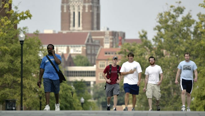 FILE - Students walk across campus at the University of Tennessee.