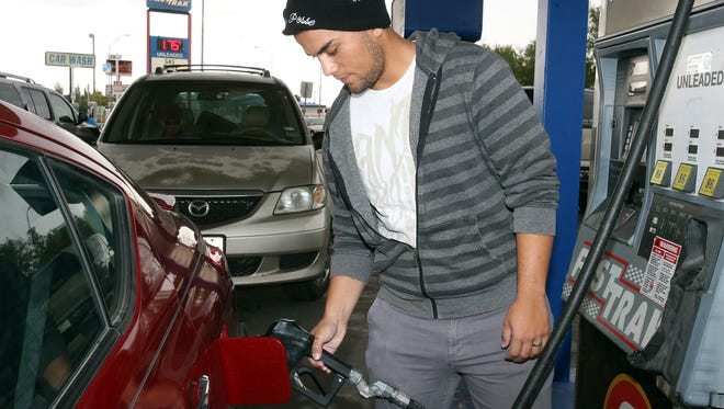 Roy Allen of El Paso fuels up at a busy Fast Trak convenience store Friday at the corner of North Loop and Lomaland drives. The going rate for regular unleaded fuel there was about $1.75.