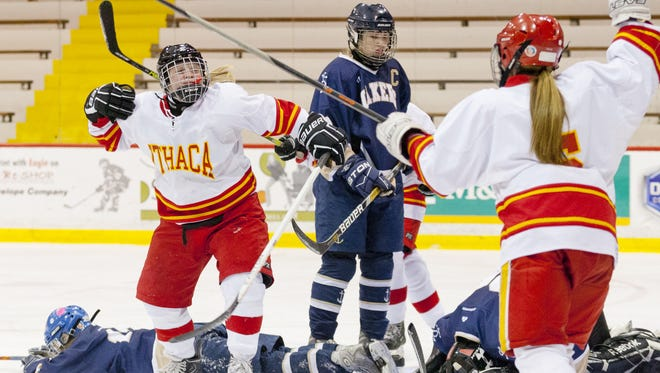 Ithaca's Madison Gneo, left, celebrates a goal against Skaneateles last season. Now departed, the Little Red will be relying on a young group to take her place on the ice.