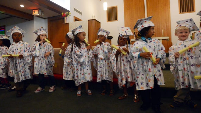 In this May 2014 file photo, students line up for Hands Up! Preschool's first graduation, which was held at Northside United Methodist Church.