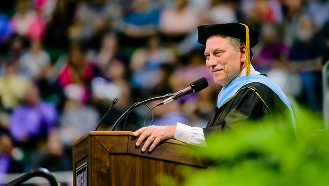 MSU Men's Basketball Head Coach Tom Izzo speaks to Lansing Community College graduates during the LCC Spring Commencement Thursday at the Breslin Student Events Center in East Lansing.