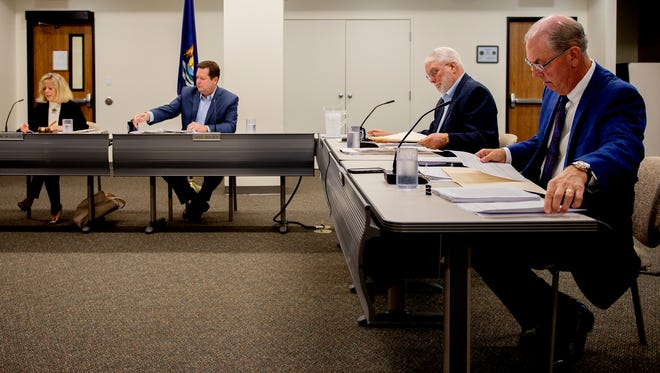 The Michigan Civil Service Commission, from left, Janet McClelland, Jase Bolger, Robert Swanson and James Barrett meet on Wednesday, Sept. 20, 2017, at the Capitol Commons Center in downtown Lansing.