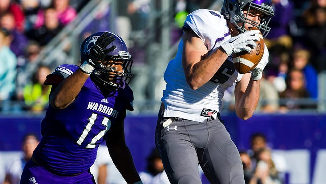 Sioux Falls wide receiver Erik Albeck (6) catches a pass in front of Winona State's Morgan Weaver (12) during a NSIC game Saturday, Oct. 25, 2014, at Warrior Stadium in Winona, Minn.