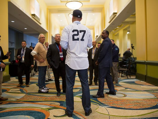 Newest Yankee Giancarlo Stanton with members of the