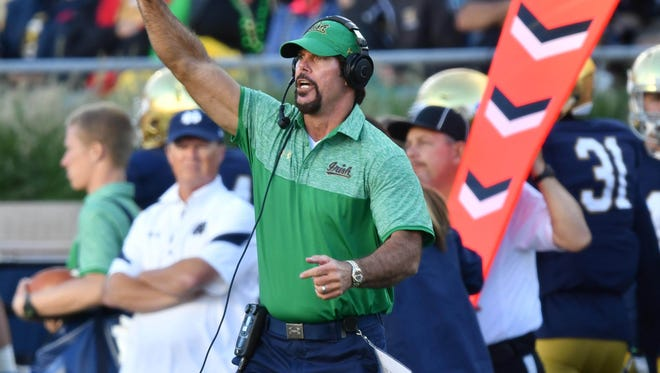 Notre Dame defensive coordinator Brian VanGorder signals to his players in the third quarter against Nevada.