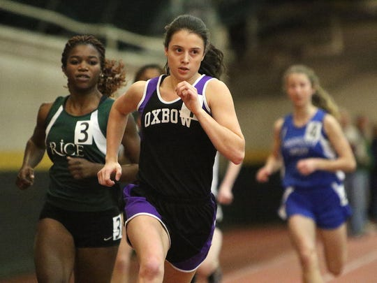 Oxbow's Izzy Giesing cruises down the stretch during 600 meter dash win at the Division II indoor track state championships on Friday night at UVM.