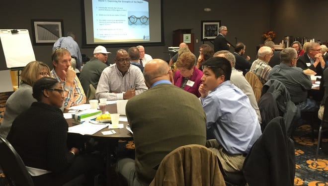 Participants talk about regional strengths during  a planning meeting for the Eastern Indiana Regional Planning Commission Thursday at the Holiday Inn in Richmond.
