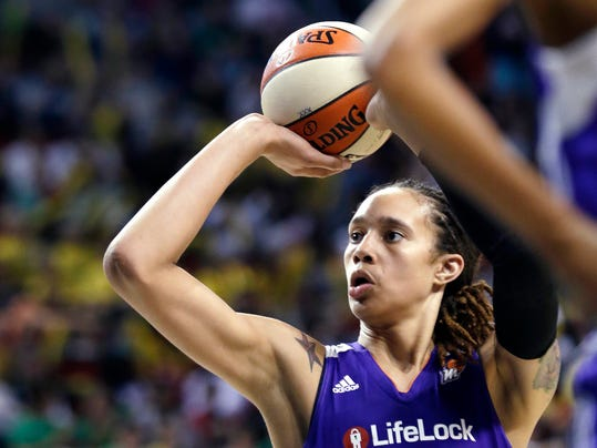 """FILE - In this June 2, 2013, file photo, Phoenix Mercury's Brittney Griner in action against the Seattle Storm in the second half of a WNBA basketball game in Seattle. Griner's busy WNBA offseason included competing in China, her first vacation in Miami and courtside seats to watch favorite player LeBron James. The slam-dunking Griner can add published author to her list of achievements with """"In My Skin,"""" which chronicles her love of basketball and struggles with bullying, sexuality and family acceptance. (AP Photo/Elaine Thompson, File)"""