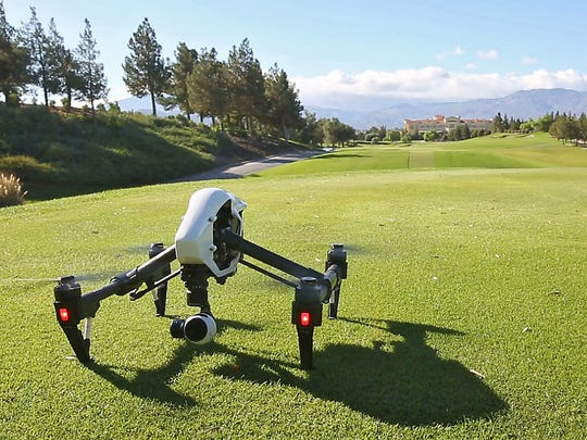 A drone takes off to do aerial videography at the Classic Club in Palm Desert, November 10, 2015.