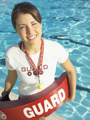 Portrait of lifeguard at swimming pool