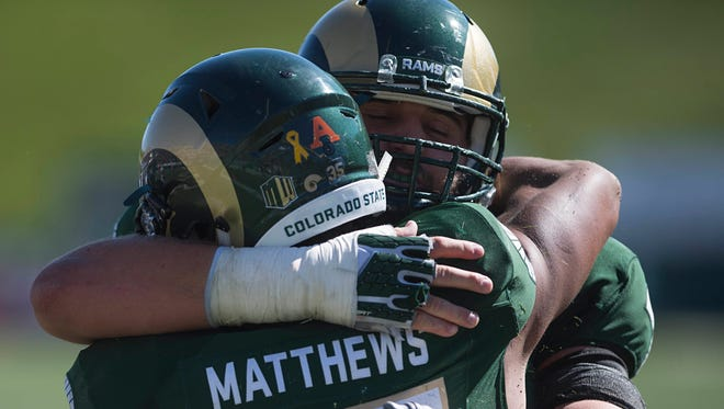 CSU running back Izzy Matthews gets a hug from teammate Jake Bennett after a touchdown against UTSA earlier this season. The Rams need to establish the run game as a priority vs. Fresno State.