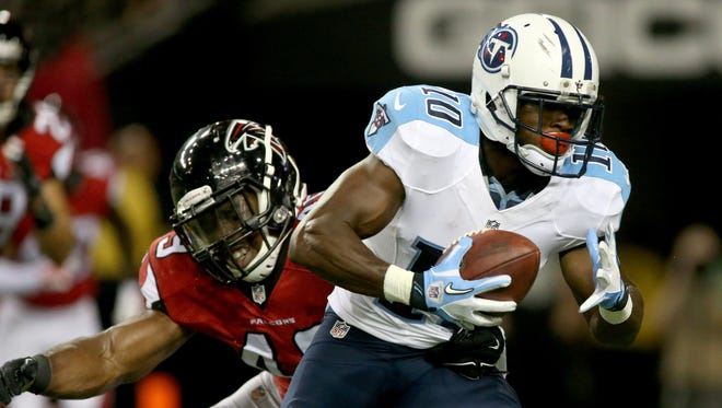 Aug 14, 2015; Atlanta, GA, USA; Tennessee Titans wide receiver Jacoby Ford (10) gets by the defense of Atlanta Falcons linebacker Derek Akunne (49) after a catch in the third quarter of their preseason NFL football game at Georgia Dome. The Falcons won 31-24. Mandatory Credit: Jason Getz-USA TODAY Sports