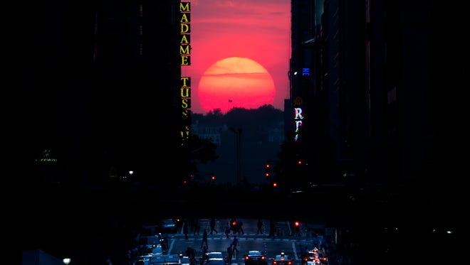 The sun sets along 42nd Street in Manhattan during a past Manhattanhenge, when the sun aligns perfectly with the city's transit grid.