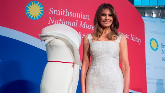 First lady Melania Trump with her inaugural gown she donated to the Smithsonian's First Ladies Collection at the National Museum of American History in Washington, Oct. 20, 2017.