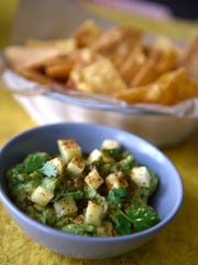 Guacamole with pineapple and house chips at Bajo Sexto.