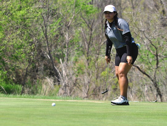 Abilene High's Brei Embers watches her putt on No.