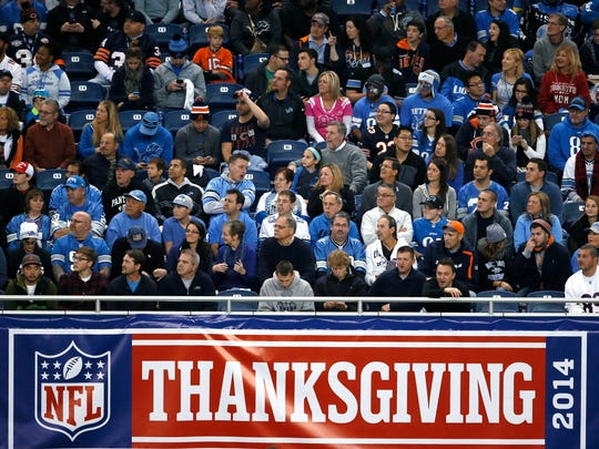 Fans attend the Lions-Bears game on Thanksgiving in 2014.