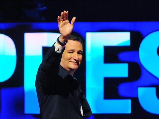 Ted Cruz waves to the crowd during the Republican debate