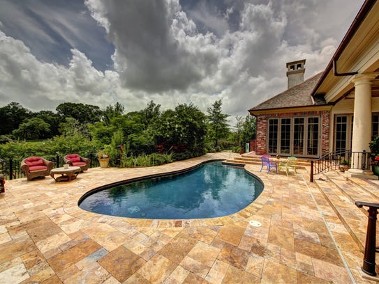 The pool is surrounded by marble deck and lounge space.