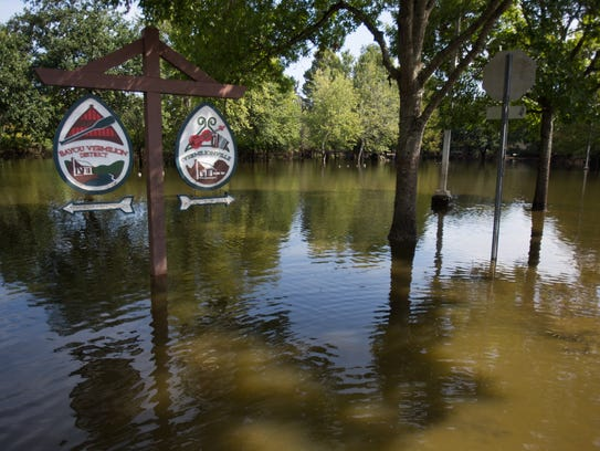 Floodwaters continued to fill the parking lot of Vermilionville