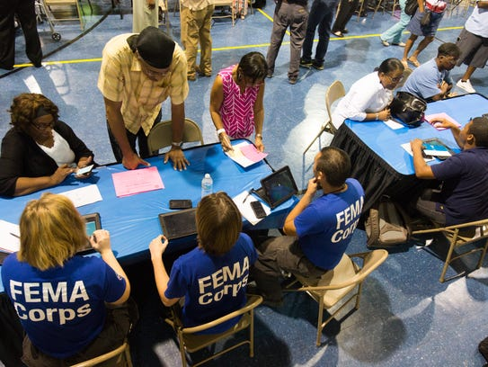 Residents meet with FEMA representatives during a meeting