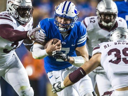 BYU quarterback Taysom Hill (7) runs past Mississippi