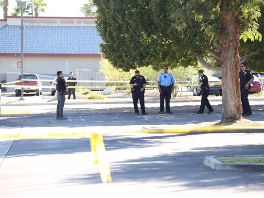 Palm Springs police investigate the fatal shooting of Abraham Ortiz, a schizophrenic man, in a Palm Canyon parking lot on Nov. 4, 2016.