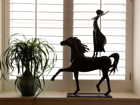 An iron sculpture in the window of Robert Daigle's