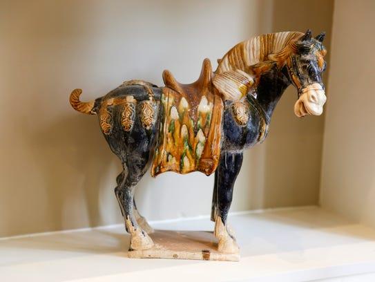 A ceramic horse sculpture inside Robert Daigle's den