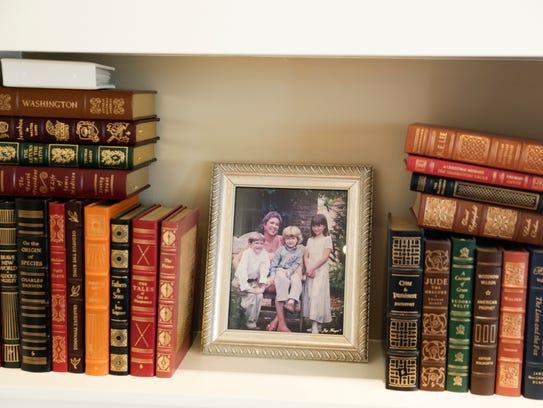 Books and photos inside Robert Daigle's den at his