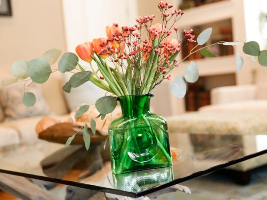 A floral arrangement on the coffee table of Robert