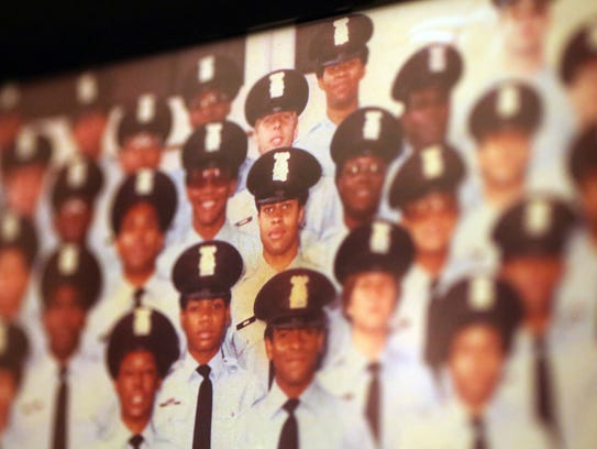 Detroit Police Chief James Craig (center) was 19 years-old
