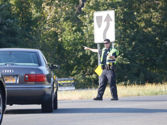 A Clarkstown police officer directs traffic away from