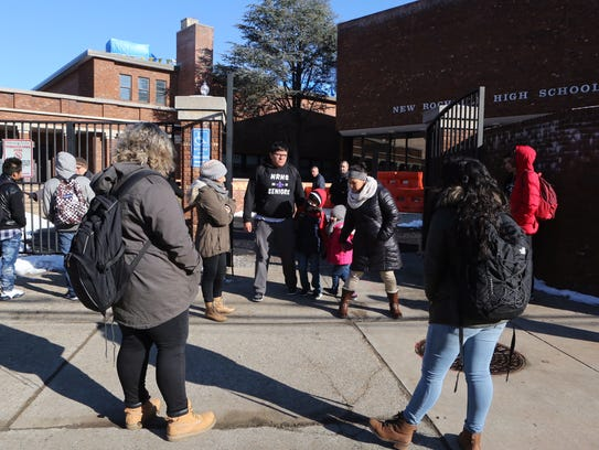 A student meets with his family after leaving New Rochelle