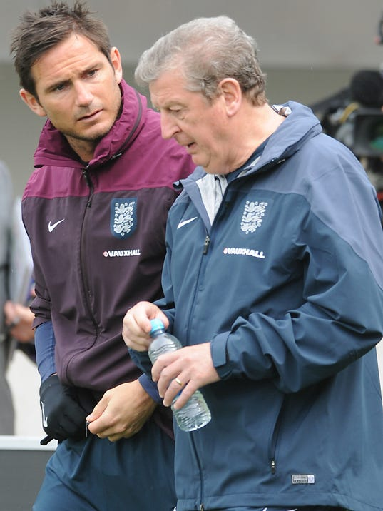 England manager Roy Hodgson, left, and Frank Lampard talk during a training session at George's Park in Burton on Trent, England, Tuesday, May 27, 2014. England play an international soccer friendly against Peru at Wembley on Friday May 30th. (AP Photo/Rui Vieira)