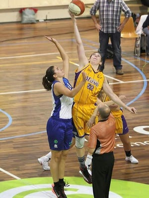 St. Clair High School graduate Rachel Kehoe goes for a jump ball this year while playing in Europe.