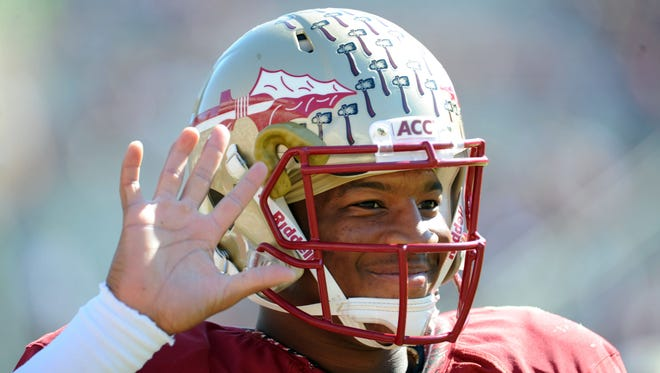 Florida State Seminoles quarterback Jameis Winston (5) warms up before the start of the game against the North Carolina State Wolfpack at Doak Campbell Stadium.