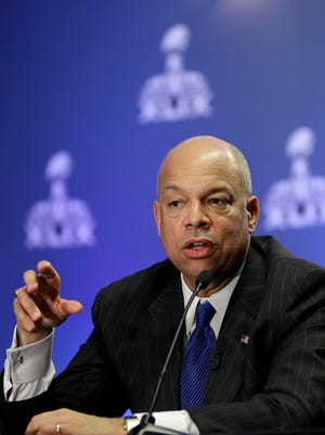 U.S. Department of Homeland Security Secretary Jeh Johnson answers a question during a Super Bowl XLIX security briefing Wednesday, Jan. 28, 2015, in Phoenix. The New England Patriots play the Seattle Seahawks in Super Bowl XLIX Sunday, Feb. 1, 2015.