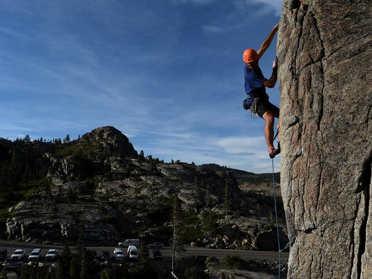 Climber Brian Biega makes his way up a granite wall up at Donner Pass near Truckee on June 30, 2015.
