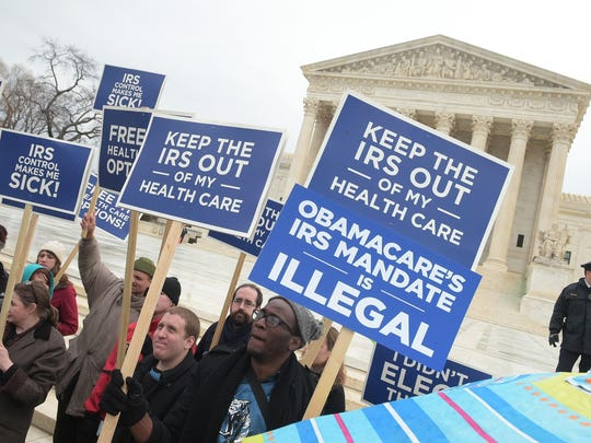 "Protestors hold placards challenging ""Obamacare"" outside of the US Supreme Court on March 4, 2015 in Washington, DC. The US Supreme Court faces a momentous case Wednesday on the sweeping health insurance reform law that President Barack Obama wants to leave as part of his legacy. The question before the court is whether the seven million people or more who subscribed via the government's website can obtain tax subsidies that make the coverage affordable. A ruling is expected in June. AFP PHOTO/MANDEL NGANMANDEL NGAN/AFP/Getty Images ORG XMIT: 541152493 ORIG FILE ID: 538520391"