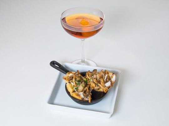 A Colonial Manhattan features three spirits; mushroom