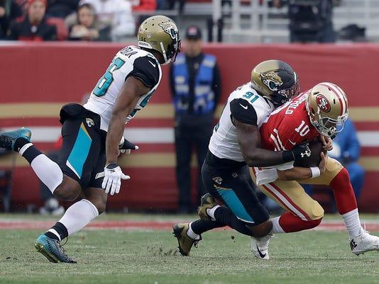 Jacksonville Jaguars defensive end Yannick Ngakoue (91) sacks San Francisco 49ers quarterback Jimmy Garoppolo (10) during the second half of an NFL football game in Santa Clara, Calif., Sunday, Dec. 24, 2017. (AP Photo/Marcio Jose Sanchez)