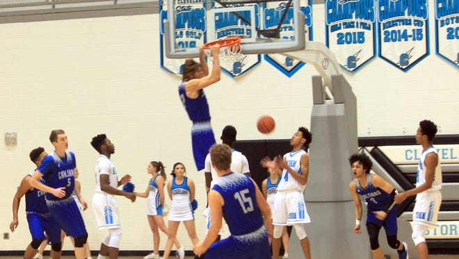 Carlsbad's Brenden Boatwright throws it down for two points Friday at Cleveland.