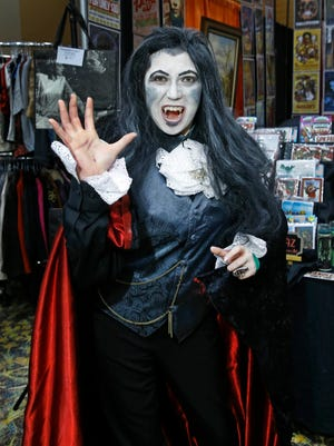 """Jaclyn Stack dresses as Graf Von Krolock, a character in the musical """"Tanz der Vampire,"""" at the Phoenix Convention Center Saturday, Sept. 24, 2016 in Phoenix. Stack really admires actor Drew Sarich, who has portrayed the vampire before. """"He has been a musical inspiration to me,"""" she said. """"I've memorized all of the songs completely, in Deutsche."""""""