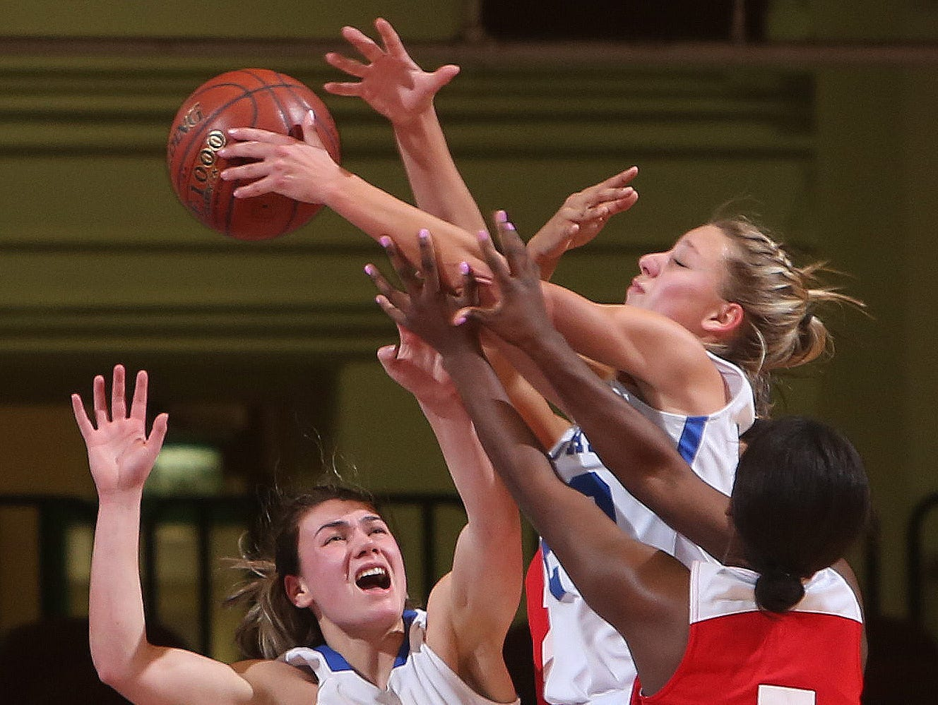 From left, Haldane's Abbey Stowell (25) and Alzy Cinquanta (20) battle for a rebound with Hamilton's Madison Hood (5) during the girls basketball Class C championship game at the Westchester County Center in White Plains March 4, 2017. Haldane won the game 47-39.