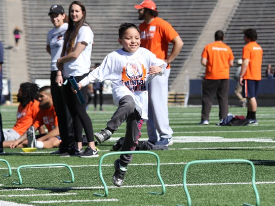 A participant in UTEP football kids' day participates