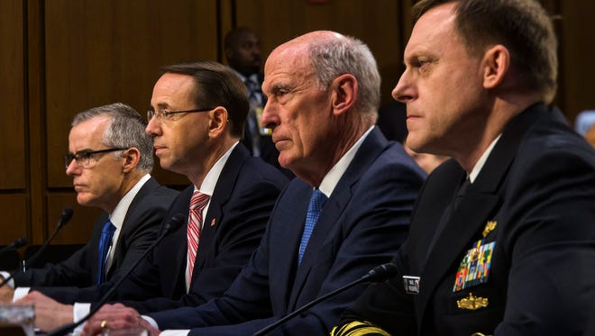 Acting FBI Director Andrew McCabe, Deputy Attorney General Rod Rosenstein, Director of National Intelligence Dan Coats and National Security Agency Director Michael Rogers testify before a Senate Intelligence Committee hearing on June 7, 2017.