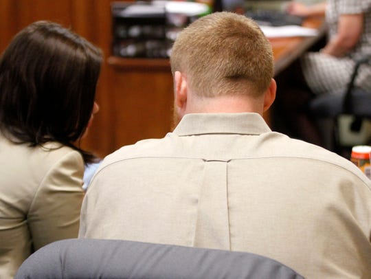 Dylan Meyer listens to his attorney during a Wednesday