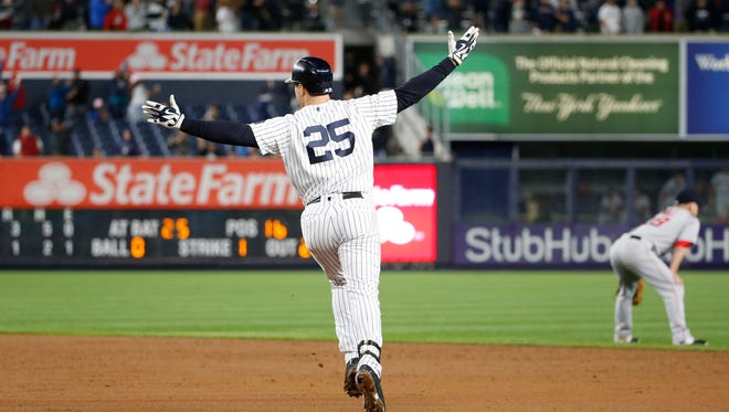 New York Yankees' Mark Teixeira (25) raises his arms in the air running the bases after hitting a ninth-inning walk-off grand slam in a baseball game against the Boston Red Sox in New York, Wednesday, Sept. 28, 2016.