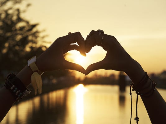 636463642758620967-Hand-heart-sunset.jpg